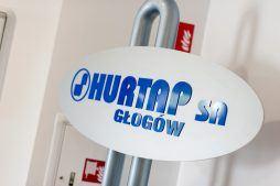 logo inwestora - hala magazynowa z budynkiem biurowym, dla Hurtap SA, Głogów, woj. dolnośląskie