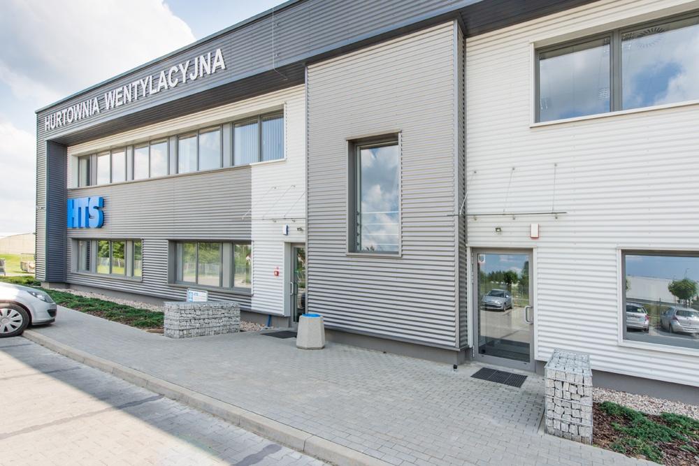 fragment elewacji frontowej 1 - hala produkcyjna z budynkiem biurowym, dla Irmark, Warszawa