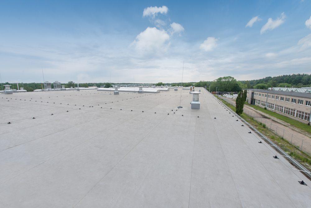 fragment dachu 2 - hala produkcyjna z częścią biurową, dla Styropmin, Łochów, woj. mazowieckie