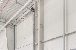 mechanizm podnoszenia bramy - hala produkcyjna z częścią biurową, dla Styropmin, Łochów