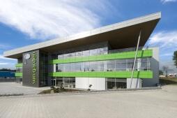 zdjęcie elewacji frontowej - hala magazynowa z budynkiem biurowym, dla Sun Garden Poland, Malanów
