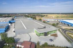 widok z lotu ptaka - hala magazynowa z budynkiem biurowym, dla Sun Garden Poland, Malanów