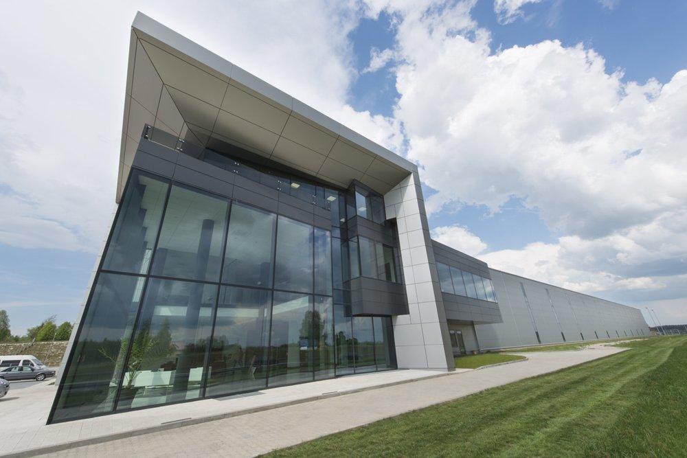 widok ogólny elewacji bocznej - hala produkcyjna z budynkiem biurowym, dla Adams, Mrągowo