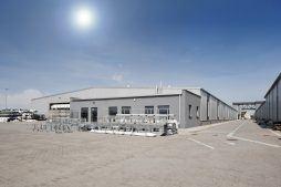 widok ogólny 1 - hala produkcyjna z budynkiem biurowym, dla Eurocolor, Pyskowice, woj. śląskie