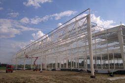 widok konstrukcji stalowej z tyłu - hala produkcyjna z budynkiem biurowym, dla Adams, Mrągowo, woj. warmińsko-mazurskie