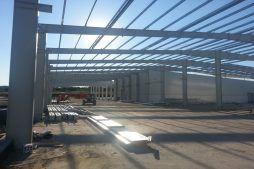widok konstrukcji stalowej - hala produkcyjna z częścią biurową, dla Leann Stańczyk, Słupsk, woj. pomorskie