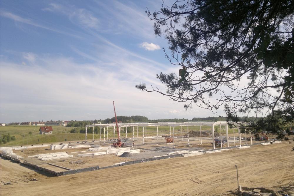 widok na konstrukcje hali - hala produkcyjna z budynkiem biurowym, dla Adams, Mrągowo, woj. warmińsko-mazurskie