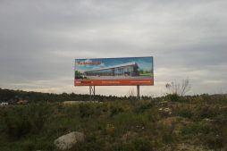baner reklamowy - hala produkcyjno-magazynowa z budynkiem biurowym, dla Jota Group, Ostróda, warmińsko-mazurskie