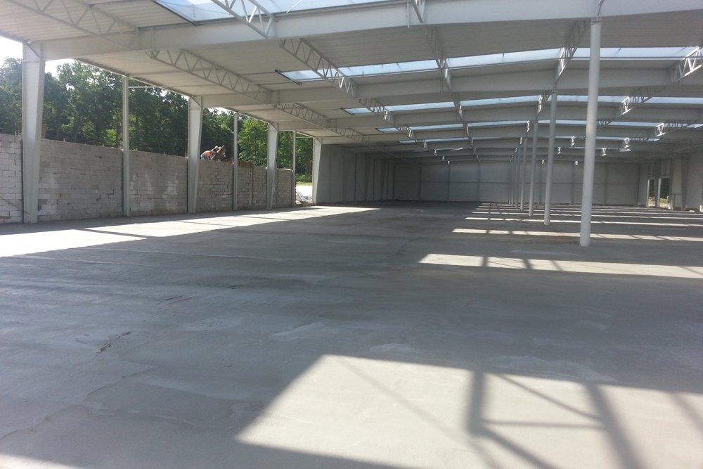 gotowa posadzka - hala produkcyjno-magazynowa z budynkiem biurowym, dla Jota Group, Ostróda, warmińsko-mazurskie