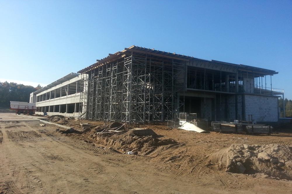 widok ogólny na budowę 1 - hala produkcyjno-magazynowa z budynkiem biurowym, dla Jota Group, Ostróda, warmińsko-mazurskie