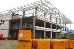 stan surowy budynku - hala magazynowa z budynkiem biurowym, dla Koesters & Meyer, Malanów