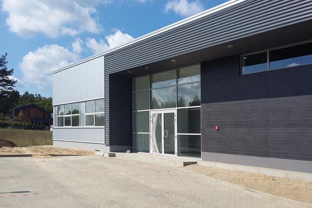 prace wykończeniowe wejścia głównego - budynek socjalno-biurowy, firma Van Den Block, Gdańsk