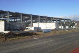 wznoszenie ścian budynku biurowego - hala produkcyjna z budynkiem biurowym, dla LÜTTGENS, Nielbark, woj. warmińsko-mazurskie