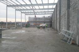 konstrukcja stalowa widziana od wewnątrz - hala produkcyjna z budynkiem biurowym, dla LÜTTGENS, Nielbark
