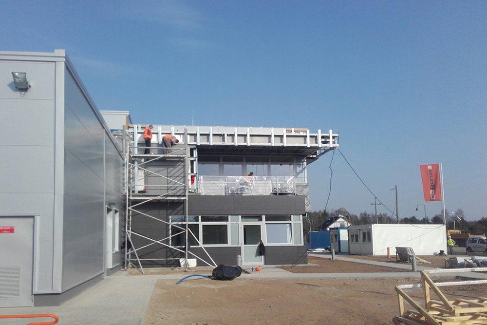 montaż paneli elewacyjnych - hala produkcyjna z budynkiem biurowym, dla LÜTTGENS, Nielbark, woj. warmińsko-mazurskie