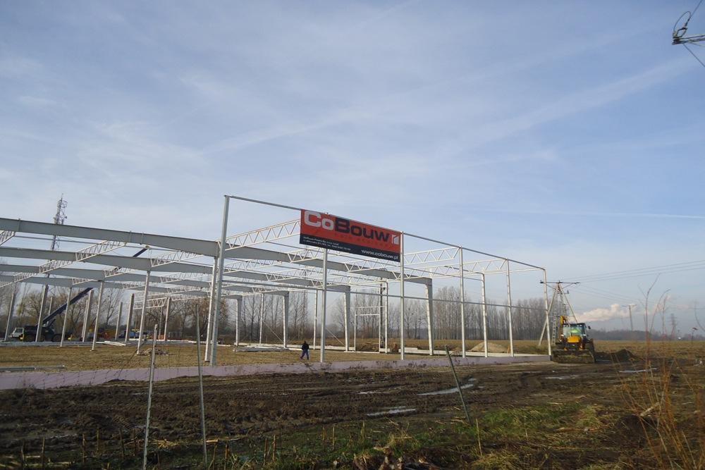 baner reklamowy na tle inwestycji - hala produkcyjna z częścią biurową, dla Arsanit, Konin, woj. wielkopolskie