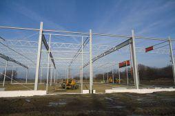 prace zwiazane z wznoszeniem konstrukcji - hala produkcyjna z częścią biurową, dla Arsanit, Konin