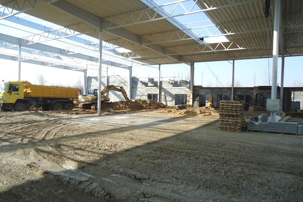 prace budowlane - hala produkcyjna z budynkiem biurowym, dla Uniservice, Skarbimierz, woj. Opolskie