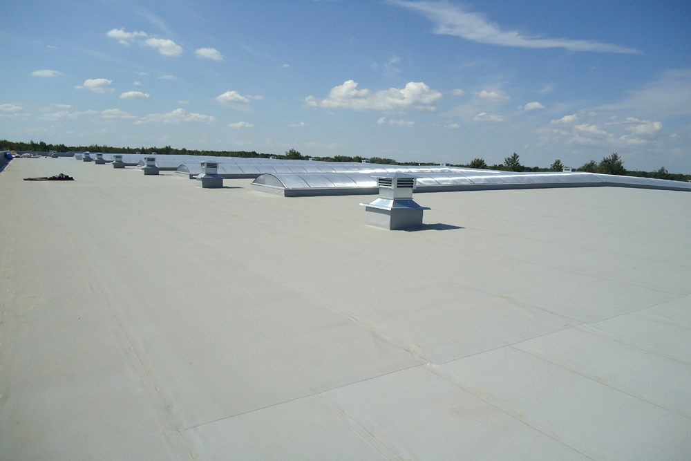 dach - hala produkcyjna z budynkiem biurowym, dla Uniservice, Skarbimierz, woj. Opolskie