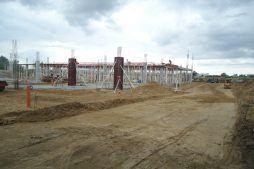 prace przygotowujące pod wykonanie drogi dojazdowej - hala handlowa, dla Koopman International, Komorniki