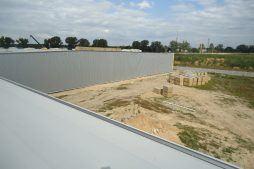 zdjęcie z dachu obiektu - hala produkcyjna z częścią biurową, dla Dinopol, Ostró Wlkp., woj. wielkopolskie