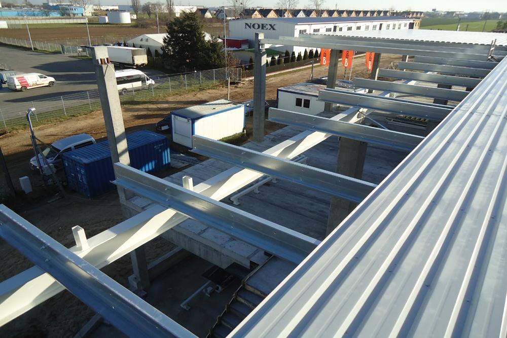 montaż pokrycia dachowego - hala handlowa, dla Koopman International, Komorniki, woj. wielkopolskie