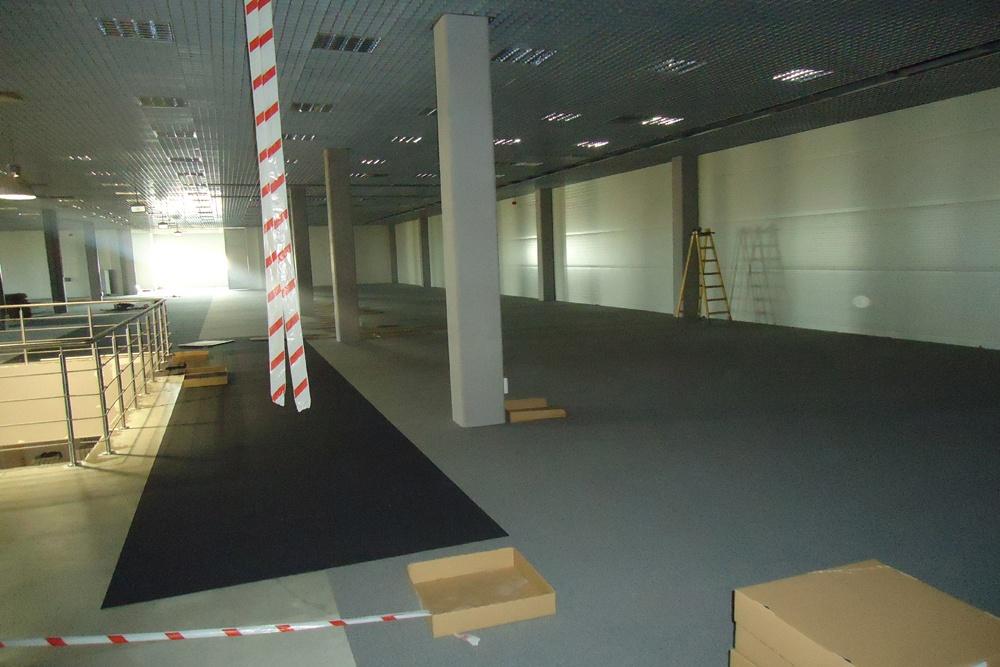 prace wykończeniowe w pomieszczeniu handlowym - hala handlowa, dla Koopman International, Komorniki