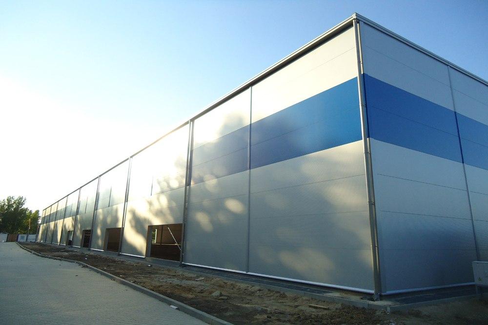 ściana tylna w trakcie budowy - hala magazynowa z budynkiem biurowym, dla Hurtap SA, Głogów, woj. dolnośląskie