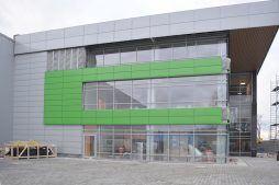 prace wykończeniowe elewacji bocznej - hala magazynowa z budynkiem biurowym, dla Koesters & Meyer, Malanów