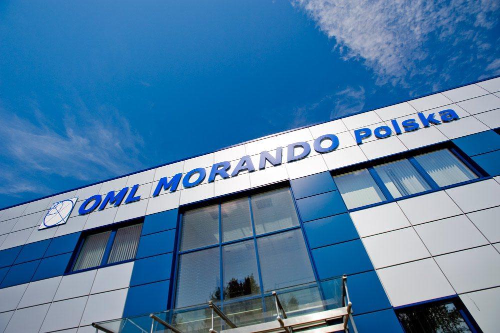 zbliżenie na logo inwestora - hala produkcyjna z budynkiem biurowym, dla OML Morando, Czerwionka-Leszczyny