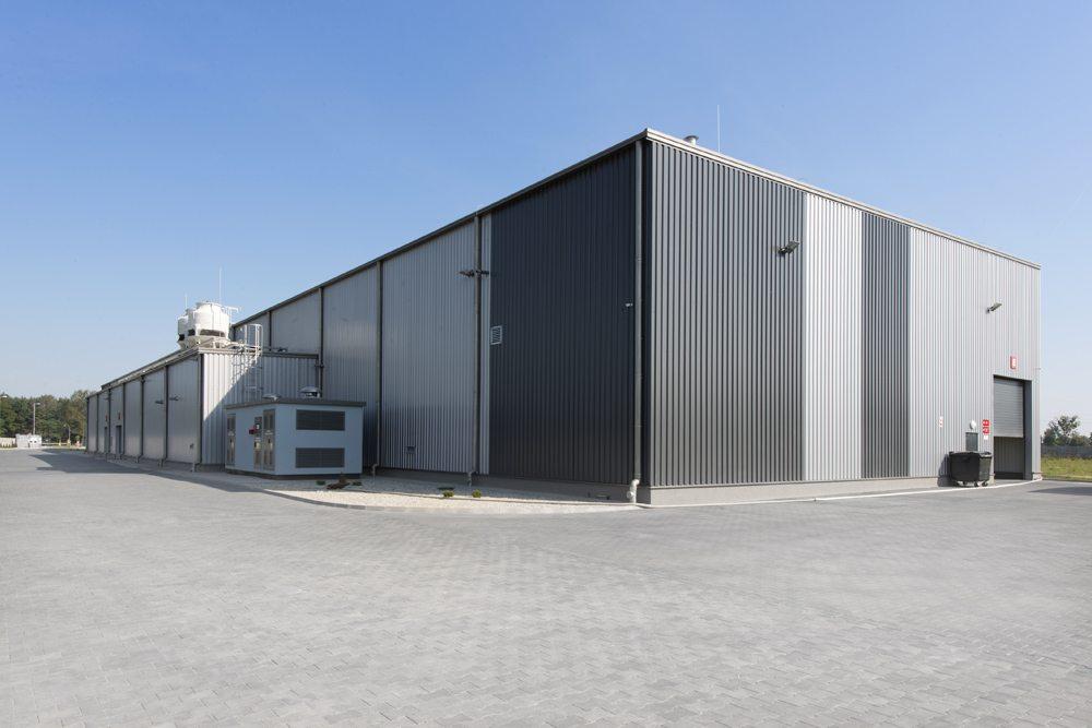 widok ogólny obiektu - hala produkcyjna z częścią biurową, dla Dinopol, Ostrów Wlkp., woj. wielkopolskie