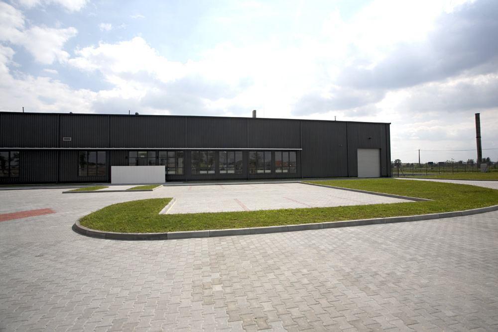 widok z przodu - hala produkcyjna z częścią biurową, dla Nome Polska, Mników, woj. małopolskie