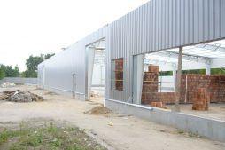 elewacja w trakcie budowy - hala produkcyjna z zapleczem biurowym, dla OMB Grzelak & Kolczyński, Łódź, woj. łódzkie