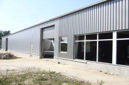 elewacja w trakcie budowy 1 - hala produkcyjna z zapleczem biurowym, dla OMB Grzelak & Kolczyński, Łódź, woj. łódzkie