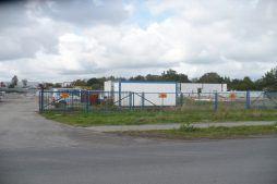 brama wjazdowa na teren budowy - hala produkcyjna z budynkiem biurowym, dla Auto-Hak, Słupsk, woj. pomorskie