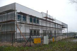prace wykończeniowe elewacji - hala produkcyjna z częścią socjalną, dla Auto-Hak, Słupsk, woj. pomorskie