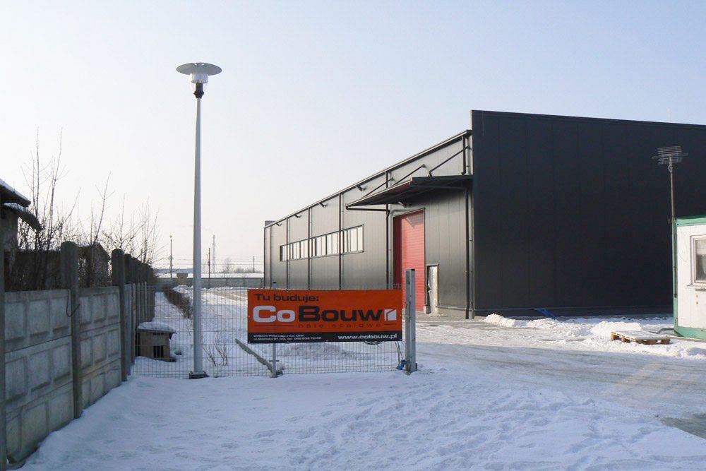 baner reklamowy na tle inwestycji - hala produkcyjna, dla Rollico Rolling Components, Lubliniec, woj. śląskie