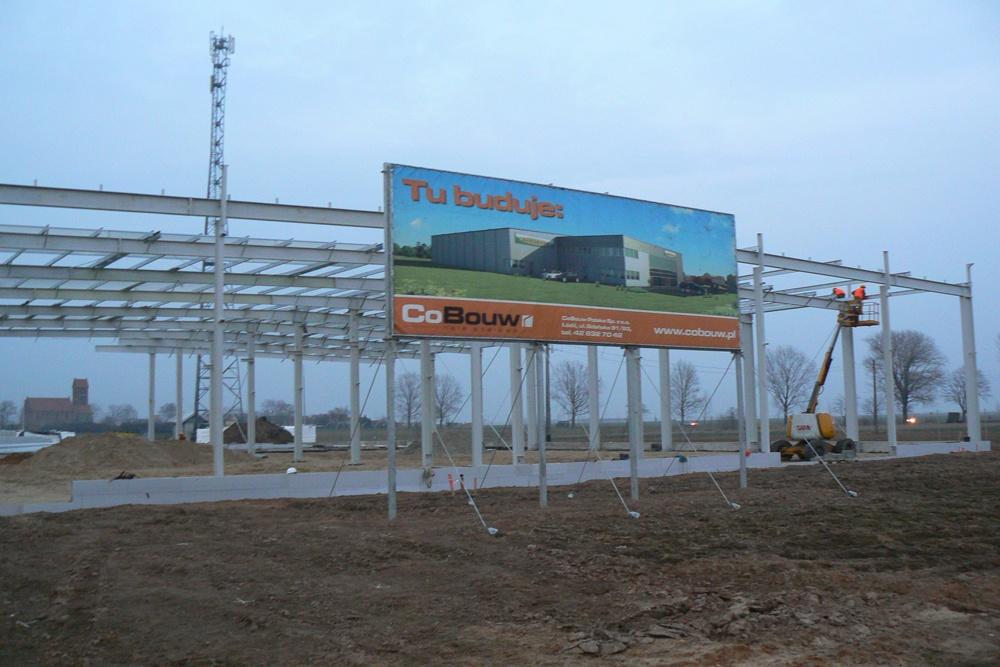 baner reklamowy na tle konstrukcji stalowej 1 - hala magazynowa z budynkiem biurowym, dla Agrarada, Domaniów