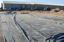 przygotowanie terenu pod wylewkę - hala produkcyjna z częścią socjalno-biurową, dla Medos, Chełmno, woj. kujawsko-pomorskie