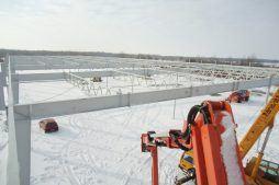 wznoszenie konstrukcji stalowej - hala produkcyjna z budynkiem biurowym, dla Uniservice, Skarbimierz