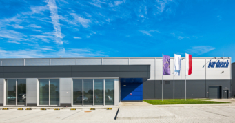 obiekt widziany od frontu - hala produkcyjno-magazynowa wraz z budynkiem socjalno-biurowym, pralnia przemysłowa, dla Bardusch Polska