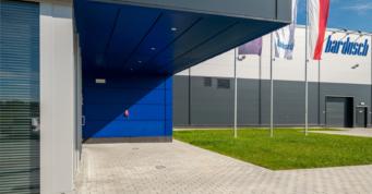 podcień - hala produkcyjno-magazynowa wraz z budynkiem socjalno-biurowym, pralnia przemysłowa, dla Bardusch Polska, w Bochni, woj. małopolskie